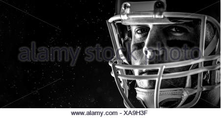 Composite image of american football player looking at camera - Stock Photo