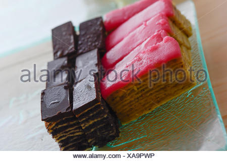 Colorful and delicious chocolate home made small cakes arranged on glass plate - Stock Photo