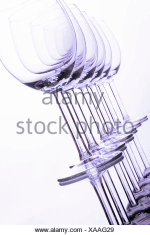 two stacked accurate rows of empty wine glasses - Stock Photo