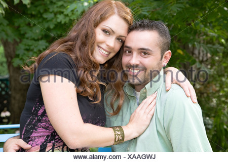 Portrait of a young couple on a summer day in the garden, Ontario, Canada - Stock Photo