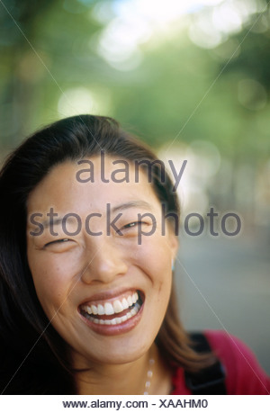 Asian woman laughing - Stock Photo