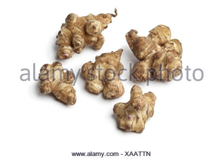 Fresh Jerusalem artichokes on white background. - Stock Photo
