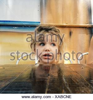 USA, Florida, Palm Beach County, West Palm Beach, Girl (2-3) sitting at table - Stock Photo