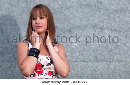 Portrait of a young woman with a dreamy look - Stock Photo