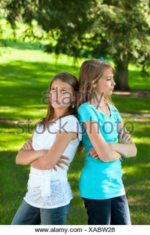 Two Sisters Disagreeing; Edmonton, Alberta, Canada - Stock Photo