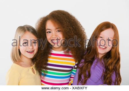 Three girls smiling - Stock Photo