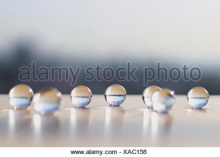 Close-Up Of Glass Marbles On Table - Stock Photo