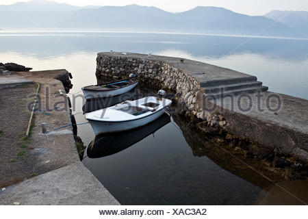 Two wooden boats in a little bay in the morning, Montenegro, Europe - Stock Photo
