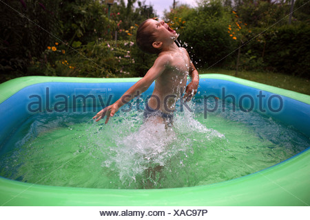 Berlin, Germany, boy rages loudly around in a paddling pool - Stock Photo
