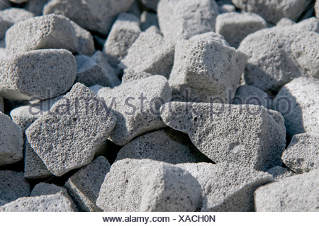 Foam glass granules, modern insulating material from waste glass for floor insulation - Stock Photo