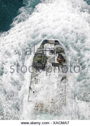 Amphibious Assault Vehicle Departs Well Deck USS Iwo Jima - Stock Photo
