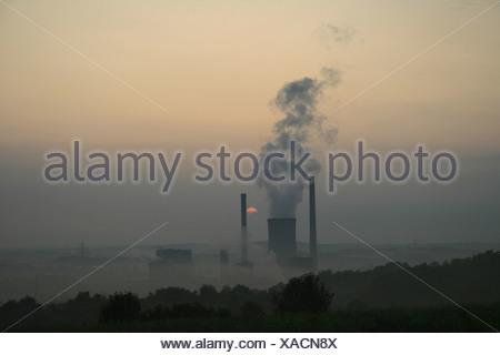 power station at sunrise, Germany, Saarland, Ensdorf - Stock Photo