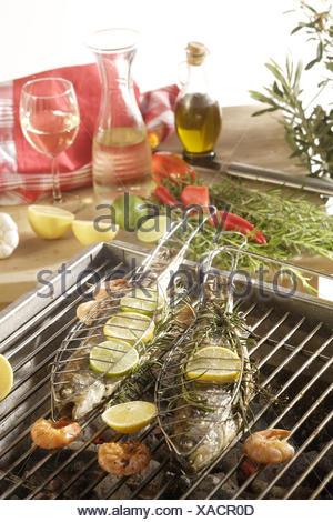 Grill, fish, river trouts, shrimps, lemon, - Stock Photo