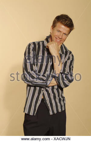 Man, smile young, shirt touched, gesture, detail, 30-40 years, stand, blond, hand, chin, laxly, casually, careless, friendly, balance, self-assurance, selfconsciousness, cool, happy, view camera, clothes, fashionably, fashion, Fashion, style, look, outfit - Stock Photo