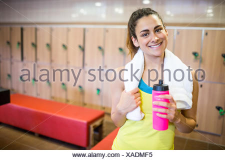 Smiling woman ready for a workout - Stock Photo