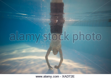 Underwater view of teenage boy in swimming pool - Stock Photo