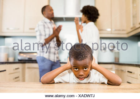 Sad boy against parents arguing - Stock Photo