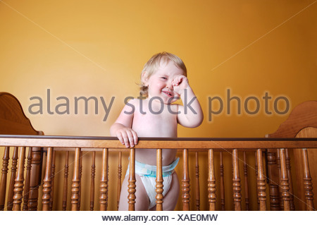 Boy In Diapers Crying In Crib Stock Photo 47419900 Alamy