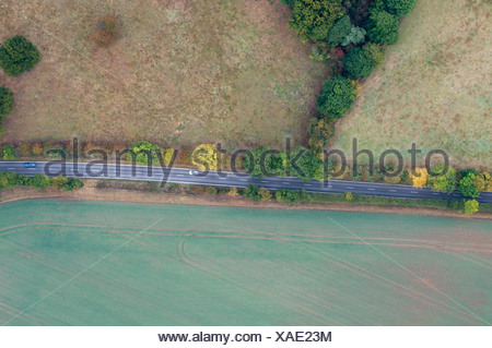 Aerial view of road cutting through countryside south of Norwich Norfolk