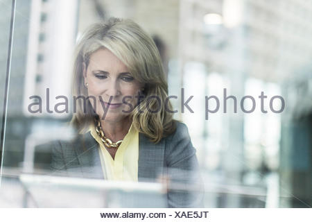Mature businesswoman with blonde hair, portrait - Stock Photo