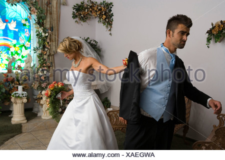 Groom leaving a bride at the altar - Stock Photo