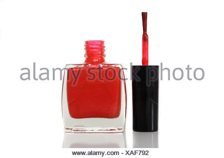 Red nail polish, nail polish bottle with brush - Stock Photo