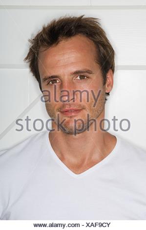 Man wearing a white t-shirt - Stock Photo