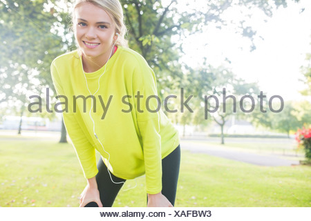 Active cheerful blonde pausing after a run - Stock Photo