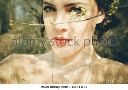 Portrait Of Beautiful Woman By Twig - Stock Photo