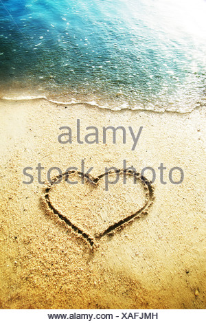 heart shape drawn in the sand - Stock Photo