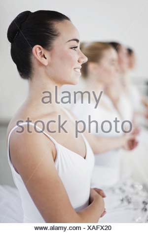 Ballet dancers holding hands in studio - Stock Photo