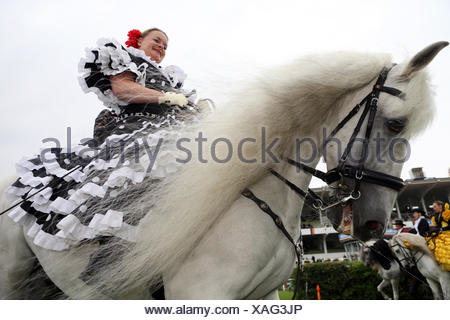 Hamburg, Germany, rider in national dress sitting on a Spanish Andalusian - Stock Photo