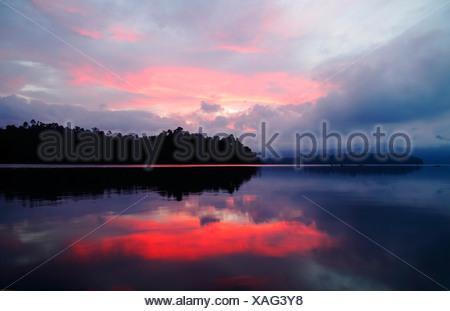 view onto the lake Chio Lan at dawn , Thailand, Khao Sok National Park - Stock Photo