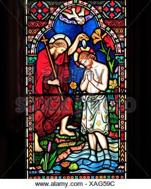 Life of Jesus, Baptism by John the Baptist, in River Jordan, stained glass window by Frederick Preedy, 1865, Gunthorpe, Norfolk, England, UK - Stock Photo