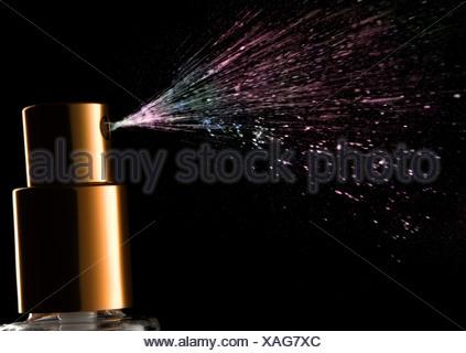 Nozzle spraying perfume - Stock Photo