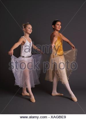Two ballerinas facing camera left. - Stock Photo