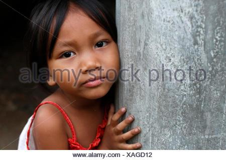 Bahnar (Ba Na) ethnic group. Young girl. Portrait. Kon Tum. Vietnam. - Stock Photo