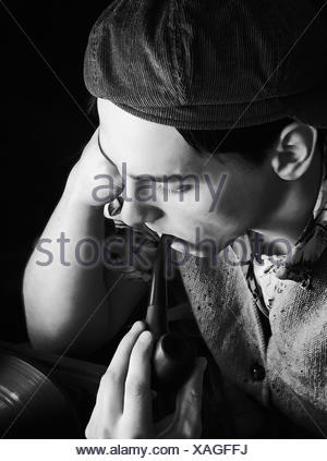Monochrome Vintage Portrait Of A Man With Pipe - Stock Photo