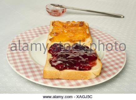 Spread jam on bread - Stock Photo