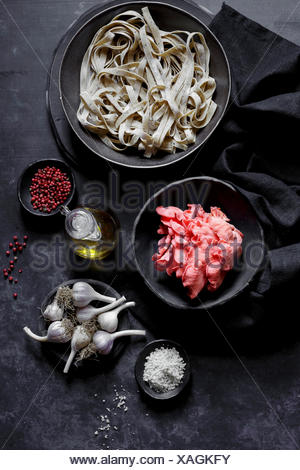 Ingredients for pasta, pink oyster mushrooms and garlic - Stock Photo