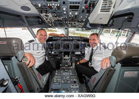 Interior view of a 737 cockpit and its two pilots,The Comox Valley - Stock Photo