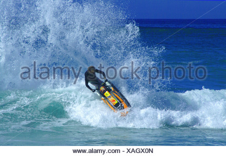A jetski having fun in the waves - Stock Photo