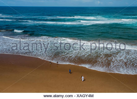 The coastline and a flat beach north of Taghazout, Morocco on a sunny day. - Stock Photo