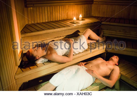 Couple relaxing in the sauna - Stock Photo