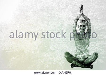 Composite image of sporty woman sitting in namaskar pose with twisted hands - Stock Photo