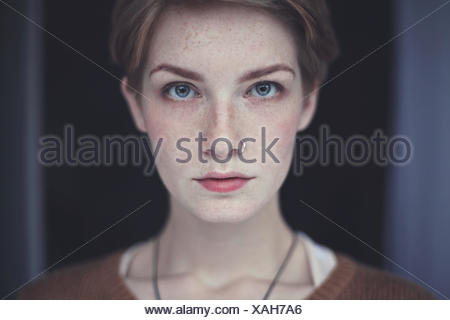 Portrait of woman with freckles - Stock Photo