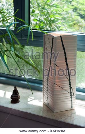Interior design, Paper lantern on a windowsill - Stock Photo