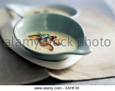 Cream of jerusalem artichokes with ceps - Stock Photo
