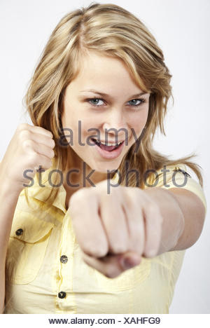 Young woman strikes - Stock Photo