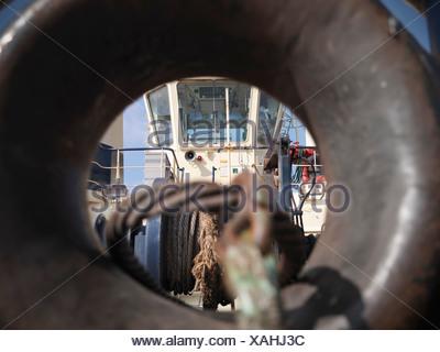 Tugboat bridge through tow line guide - Stock Photo